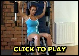Video of a busty babe working out topless