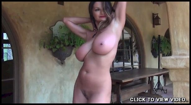 Video of a busty babe stripping