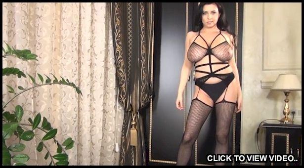 Busty brunette posing in sexy lingerie