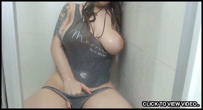 Busty cam girl doing a shower show