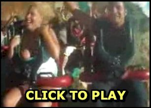 Girl flashing boobs on a rollercoaster
