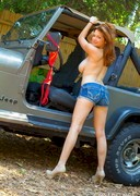Tessa Fowler strip in a car