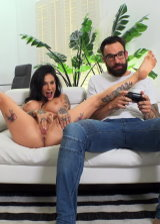 Busty Tattooed Chick Fingering Her Pussy