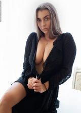 Busty Beauty In Black Dress
