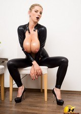 Oiled Boobs In Latex Suit