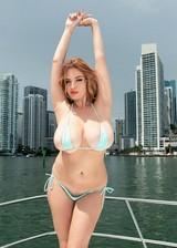 Busty Babe In Tiny Bikini