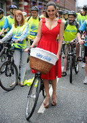 Kelly Brook Rides a Bike in a Red Dress