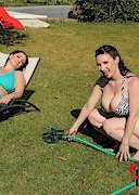 Karina Hart and Michelle Monaghan Play with a Hose