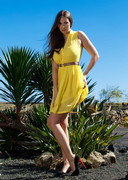 Connie Carter in a Yellow Dress