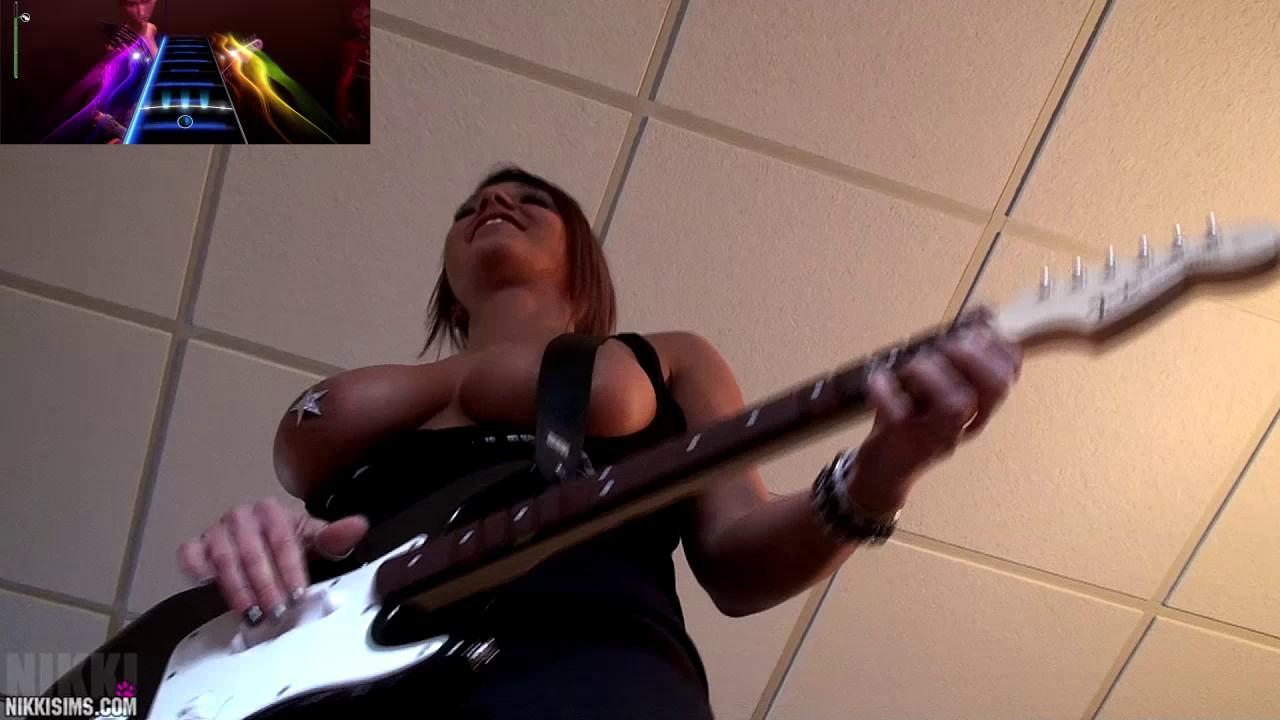 Nikki Sims Playing Guitar Hero!
